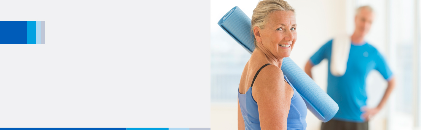 Elderly woman with a yoga mat